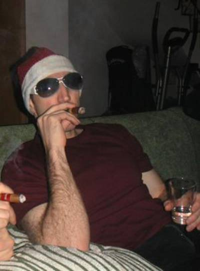 A dissolute Imagethief wallows in empty, carnal indulgence on Christmas eve with a fat smoke and Finnish vodka. Jackie O. shades hide eyes full of shame.